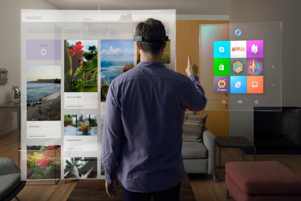 Největší překvapení, které Micosoft úzkostlivě tajil, vyrazilo návštěvníkům tiskové konference dech. Jde o HoloLens, průvodce virtuální realitou, jinak technikou nadupané brýle. (zdroj: Microsoft)
